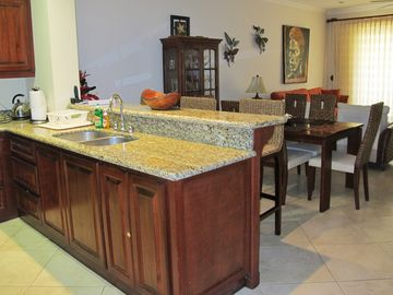 Fully Stocked Kitchen with Granite Countertops & Kitchen Bar