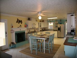 Anastasia Island house photo - Extra large eat in kitchen, wood burning fireplace. Everything you need is here.