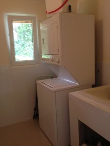 Laundry room with washer, dryer and washboard/sink