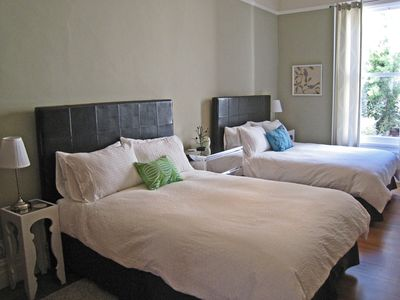 Huge bedroom with two (2) queen-sized beds, walk-in closets and a 32' LCD TV.