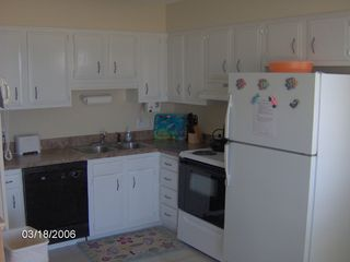 Carolina Beach condo photo - The kitchen is equipped with all you need to eat in - or walk to restaurants