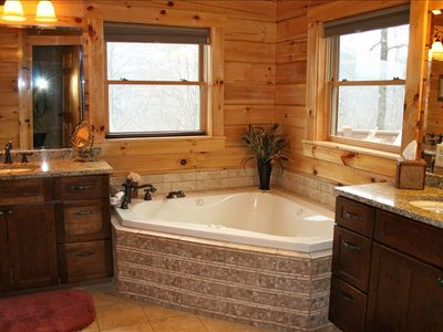 Master Bathroom with Jacuzzi Tub, 2 sinks, and a walk in shower.