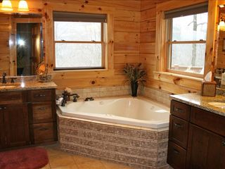 Black Mountain lodge photo - Master Bathroom with Jacuzzi Tub, 2 sinks, and a walk in shower.