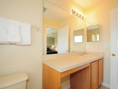 Master enquite bathroom - a light and large bathroom with bath and shower.