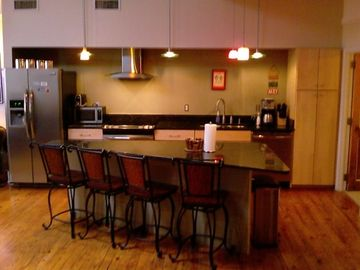 A chef's kitchen. Fully equiped SS appliances, granite counters, maple cabinets.