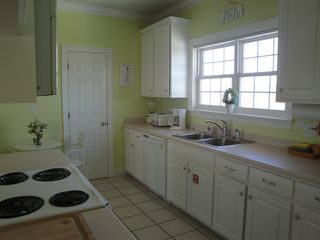 El Centro Beach house photo - Bright sunny kitchen fully stocked for all of your vacation menus