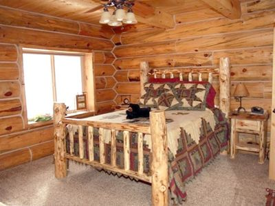 "Master Suite bed with log cabin comforter and ""bear!"""