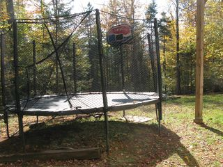 Winhall house photo - Backyard trampoline
