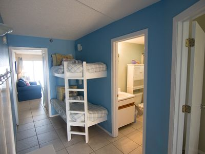 Bunk beds for the kiddos. Pocket door separates the living room for quiet-time.
