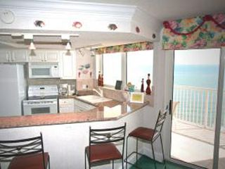 Sea Watch condo photo - Fully Equipped Eat in Kitchen with Granite Counter Tops, Breakfast Bar & Views