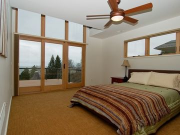 Master bedroom with deck overlooking the lake
