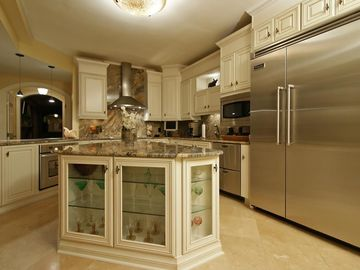 Orange Beach condo rental - Large Gourmet Kitchen with island, all limestone flooring through out the unit.