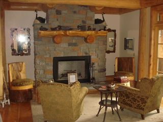 Cooperstown cabin photo - One of the main level sitting areas with wood burning fireplace