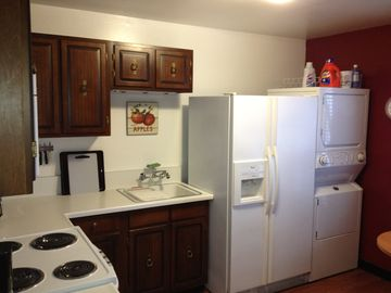 Fully- equipped kitchen with washer/dryer, fridge, stove, coffeemaker, etc.