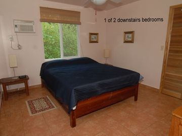 One of two 1st floor bedroom each has queen size beds and air conditioning