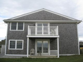 Dennisport condo photo - The End Unit with Ocean View from a private deck, 100 feet from the beach.