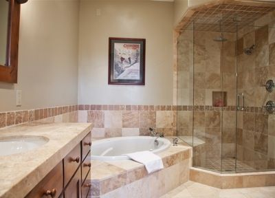 Master bath with jetted tub, glass shower