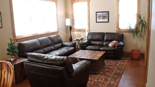 Durango house photo - A bright living room with comfy leather couches.