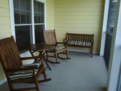 Screen porch overlooking 1st Fairway and woods