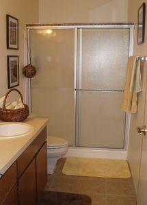 Master bath with grab bars, shower only. Main bath has shower and tub