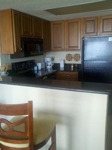 Updated kitchen with granite counter tops and breakfast bar.