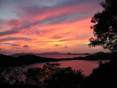 Sunset views from your private deck at THE HAWKS NEST on St. John's North Shore