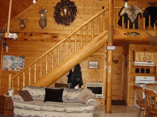 Rapid River lodge photo - Log Stairway to upper bedrooms