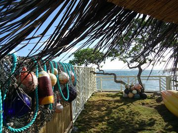 Hauula studio rental - Private backyard - local bouys and nets found on our beach