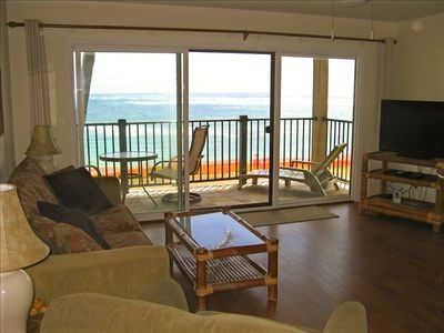 Living Room with wood flooring and a great view of the ocean