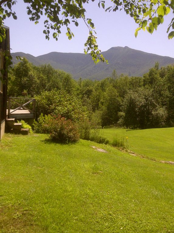 Summer view of Mt Mansfield from alongside house