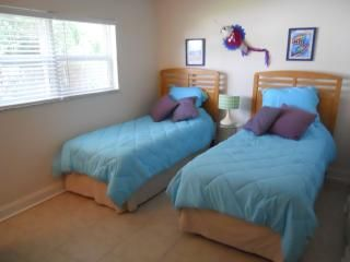 Cocoa Beach condo photo - 2nd bedroom has two twins. An extra mattress is available for additional guests