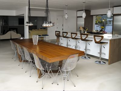 Light-filled open kitchen and dining table for 12-14 guests--views, views!