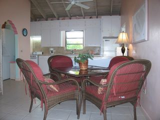 Dining area & fully-equipped kitchen. Dining table seats 4 + 2 bar stools. - Spanish Wells villa vacation rental photo