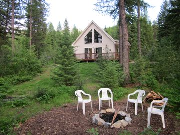West Glacier house rental - House & fire pit with miles of Forest Service land behind