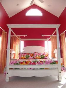 Luxurious King Sized Canopy bed with lush, tropical comforter.Ocean View
