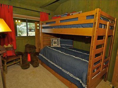 Three bunk beds in bear den room