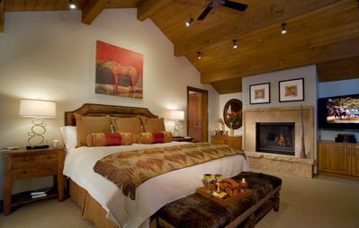 Decadent master bedroom suite with fireplace