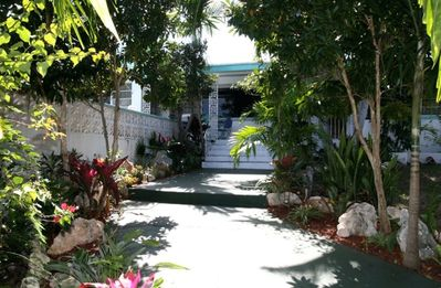 Front entrance to 3-bedroom unit showing tropical foliage