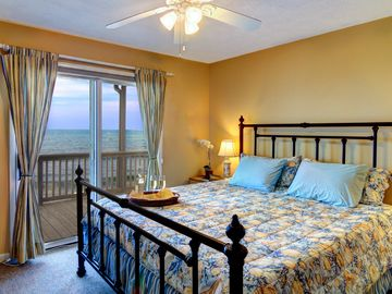 Large beachside master bedroom with separate access to the oceanfront balcony