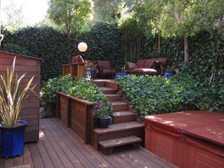 Corte Madera house photo - view of rear decks w spa and cushioned outdoor furniture