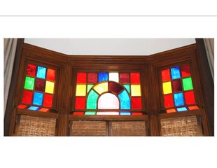 Newport house photo - Queen Anne stained glass transom windows in the Spring Room.