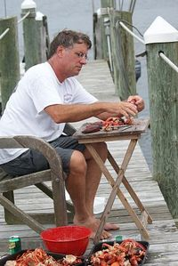 eating lobster on the dock