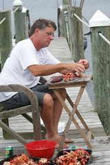 Narragansett estate photo - eating lobster on the dock