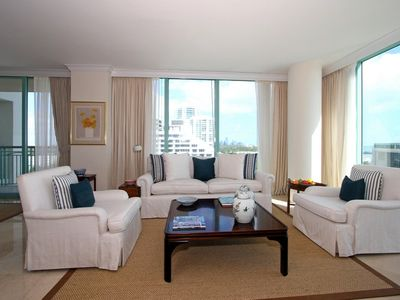 The living room is bright and has beautiful views of Biscayne Bay.