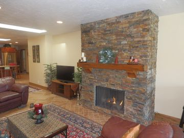 Prospector Square condo rental - Living Room w stacked stone fireplace