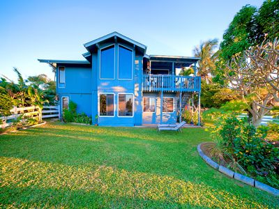 Maui mountain home with lanai, yard, and flower garden.