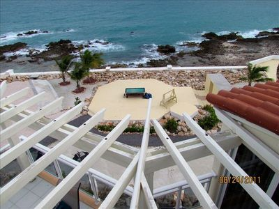 Patio view from Penthouse of ocean and outdoor pool table and beach bar