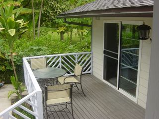 Waialua house photo - Enjoy breakfast and an ocean view from your patio.