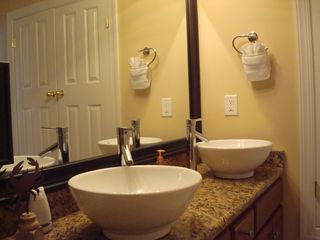 Ocean Reef condo photo - New master double vanity with granite counter top and porcelain basins