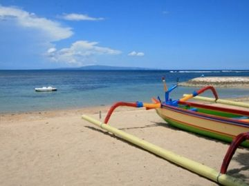 Sanur's family-friendly, white sand beach via a private entrance